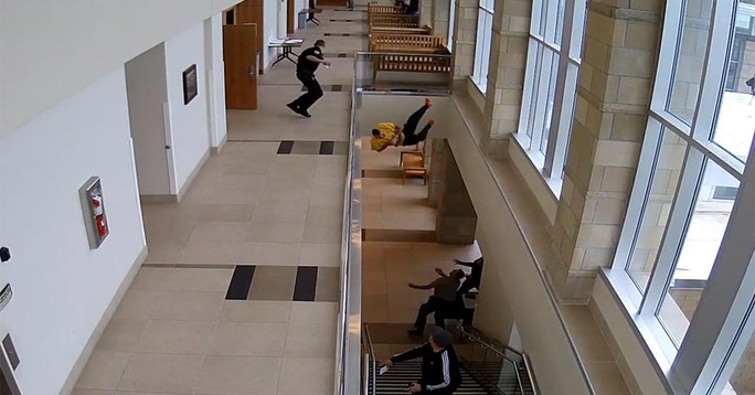 Handcuffed Inmate Dives Over Courthouse Balcony